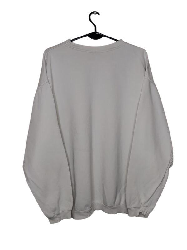 Biała bluza firmy reebok. Widoczne ślady noszenia i plamy.