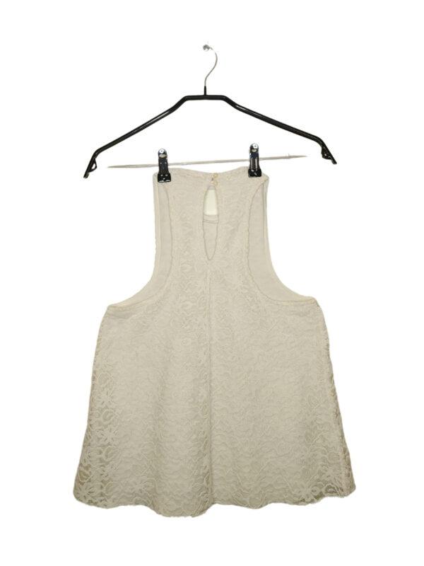 Biała, koronkowa bluzka z podszewką.