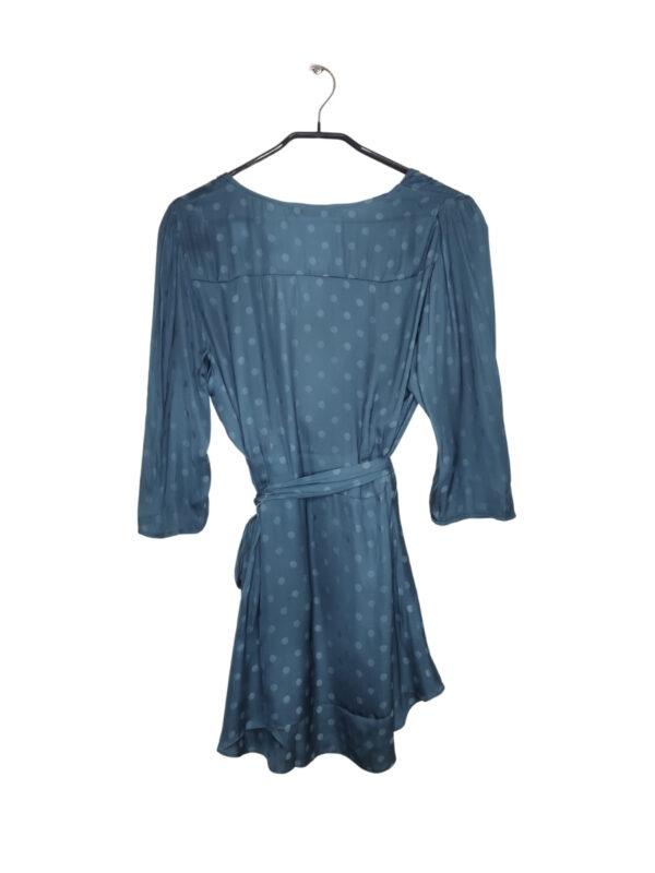 Niebieska transparentna koszula w kropki z rekawami do łokci. Wiązana i zapinana na guzik w talii. Przy metce dodatkowe guziki i nitka. Nowa z metką.