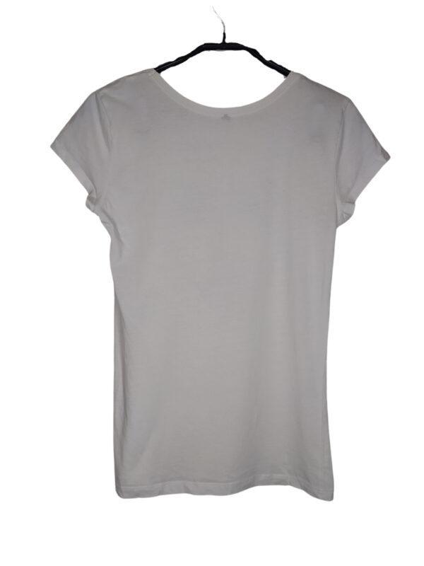 Biała bluzka z czarnym nadrukiem twarzy. Widoczne ślady noszenia