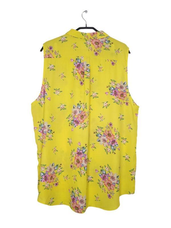 Żółta bluzka koszulowa w kolorowe kwiaty. Zapinana na guziki.