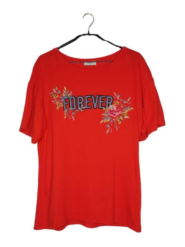 Pomarańczowa bluzka z napisem FOREVER w kratkę. Obok kwiatowy haft.
