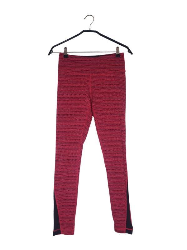 Różowe legginsy sportowe w czarne paseczki. W środku mała kieszonka.