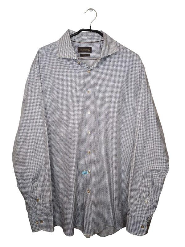 Biała koszula w brązowe kropki z granatową obwódką. Na dole od spodu przyszyte zapasowe guziki.