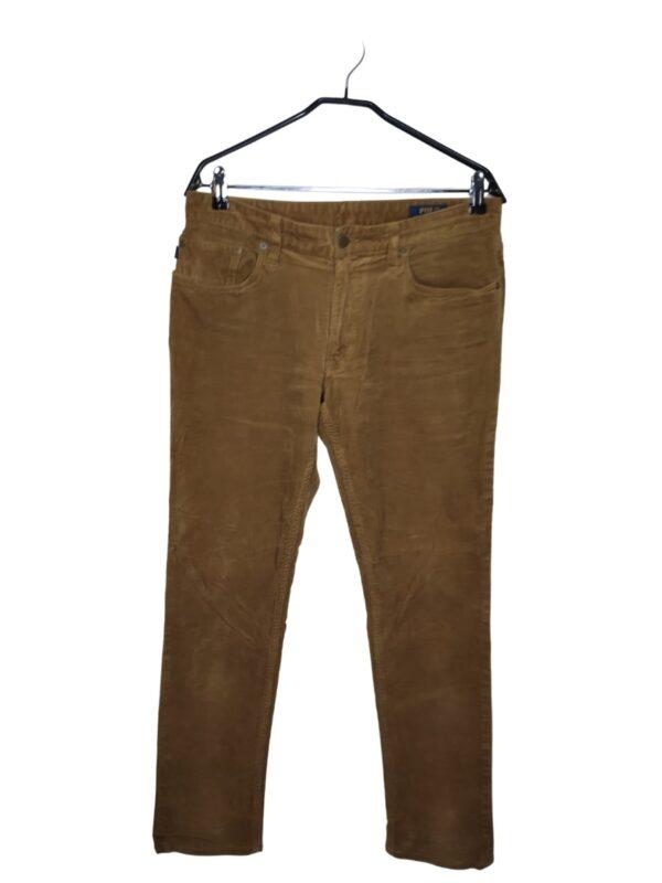 Sztruksowe, beżowe spodnie. Widoczne ślady noszenia.